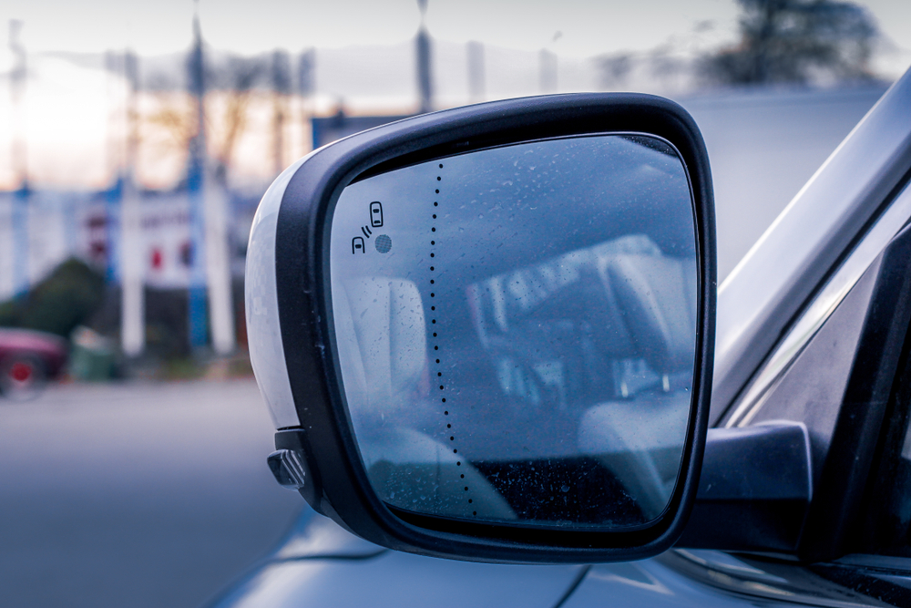 A collision avoidance system on the side mirror of a car