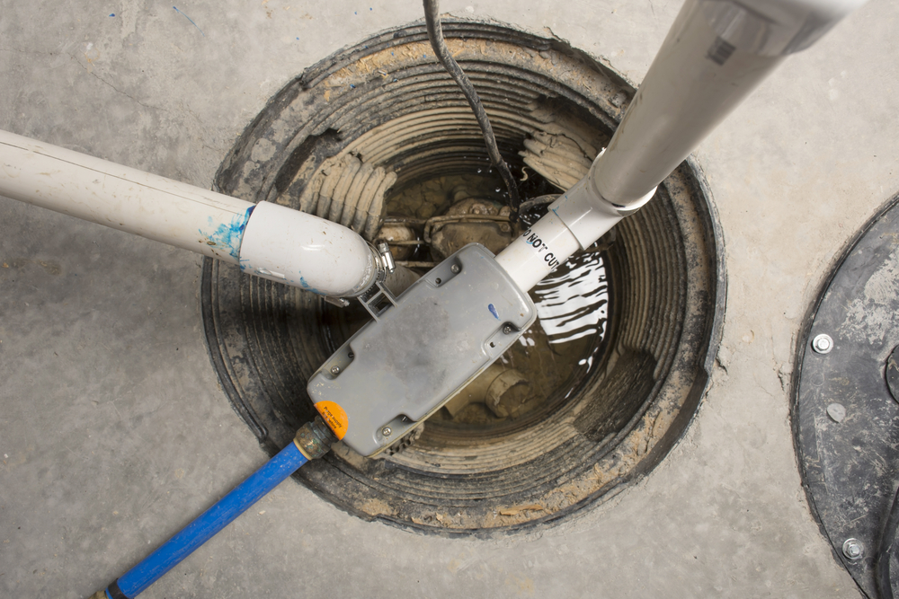 A sump pump in an unfinished basement