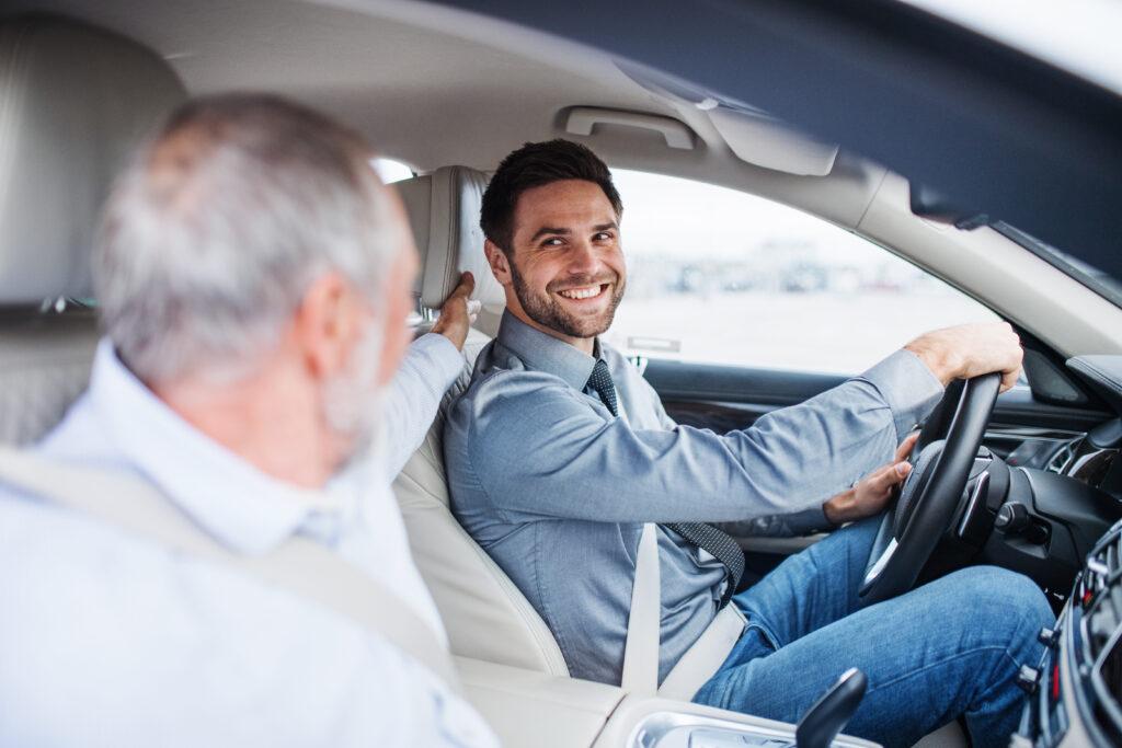 son driving older parent